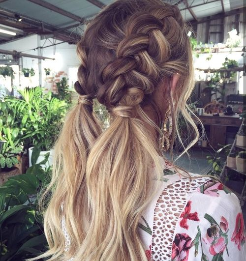 Boxer braids with loose ends is a fresh take on the trend